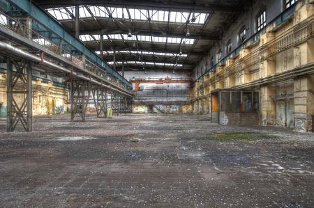 abandoned warehouse: Large abandoned warehouse with an old crane