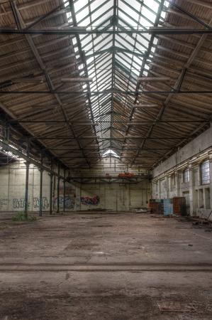 abandoned warehouse: Large abandoned warehouse with a large skylight
