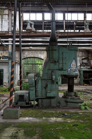 Old machine for punching metal in a production hall