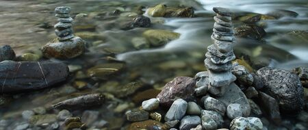 cairns: Two cairns in a river Stock Photo