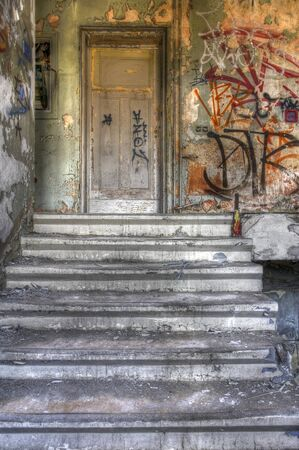 Stairs to a hospital room with an old door