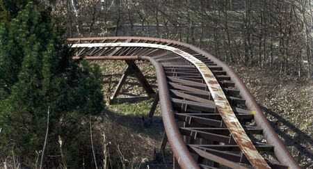 treed: Roller coaster rails in an abandoned amusement park