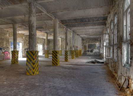 Abandoned warehouse with windows and post