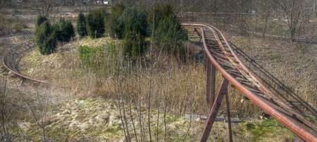 treed: Old rusty rails of a roller coaster