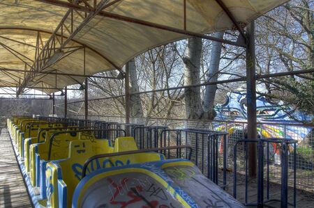 treed: Old roller coaster in an abandoned amusement park