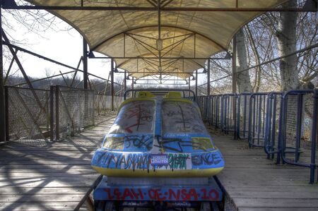 treed: View of an old roller coaster at an abandoned amusement park