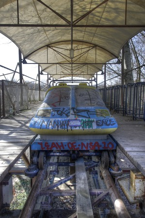 treed: Look at an old car of a roller coaster in an abandoned park