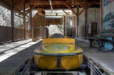 Departure station for the log flume at an abandoned amusement park photo