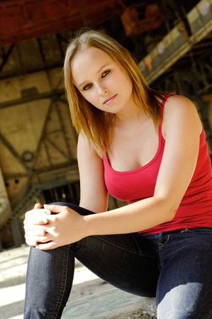 Young woman on a shoot in an abandoned hall photo