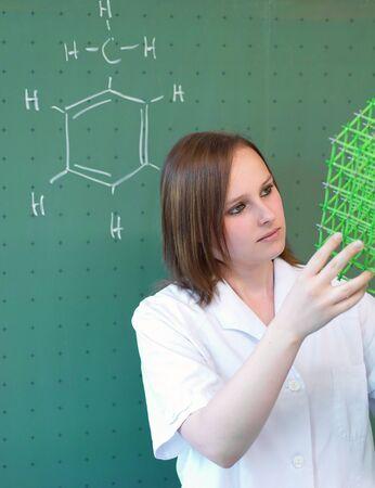 若い女性の分子モデルの検討 写真素材