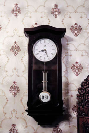 Black Old clock on the wall, vintage