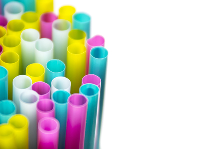 Colorful straws close up on white background Stock Photo