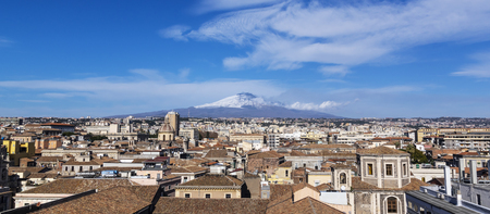Rooftops of Catania in Sicily. In background majestic volcano Etna