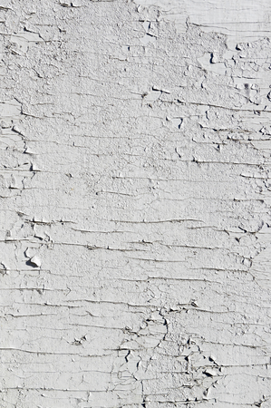 Texture of few layers of cracked, peeling off old white paint Stock Photo