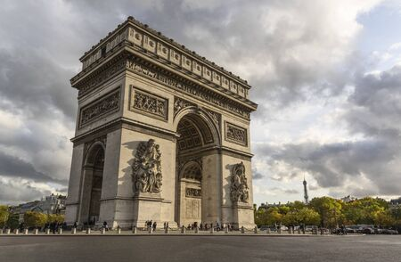 Arc de Triomphe in Paris. In distance there is visible Eiffel Tower