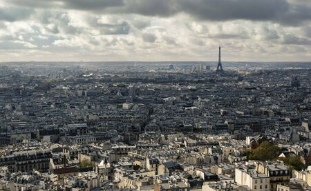 Cityscape of Paris on cloudy day. Visible Eiffel Tower