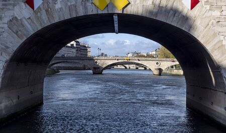 View of Seine River from under the Pont Marie in Paris. Picture taken from the boat on sunny autumn day 版權商用圖片 - 134334945