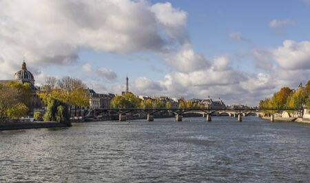 Seine River crossing Paris. Closest bridge is Pont des Arts. On the left you can see dome of Institut de France and Eiffel Tower in the distance