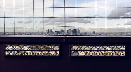 Tower buildings of La Defense, French capital business district in Paris seen through barrier on a top of Eiffel Tower 版權商用圖片 - 134332219