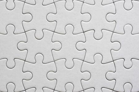 Close up on blank, white jigsaw puzzle texture 版權商用圖片