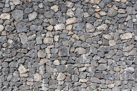Texture of stone wall made of volcanic rocks 版權商用圖片 - 140351267