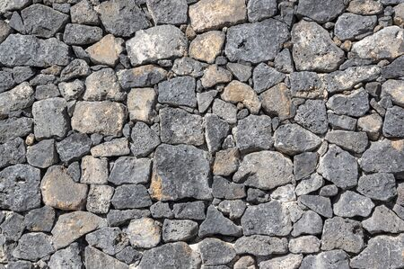 Texture of stone wall made of volcanic rocks