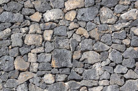 Texture of stone wall made of volcanic rocks 版權商用圖片 - 140351110