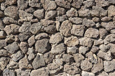 Texture of stone wall made of volcanic rocks 版權商用圖片 - 140351356