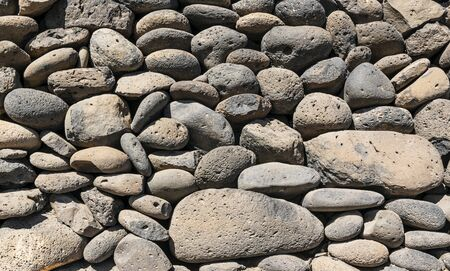 Texture of stone wall made of volcanic rocks 版權商用圖片 - 140351437