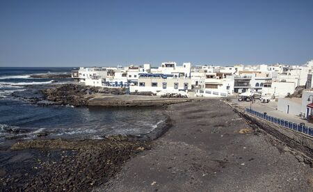 Old port and buildings of small town El Cotillo north of Fuerteventura Island, Canary Islands 版權商用圖片 - 140562201