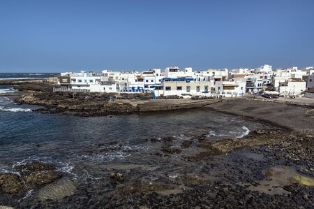 Old port and buildings of small town El Cotillo north of Fuerteventura Island, Canary Islands 版權商用圖片 - 140562270