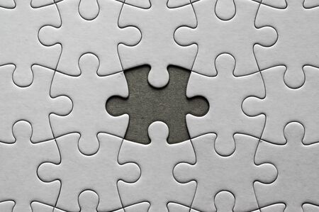 Blank, white jigsaw puzzle close up. One piece is missing 版權商用圖片 - 142894190