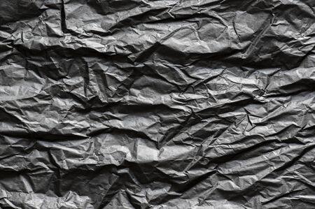 Black, creased, blank paper texture 版權商用圖片