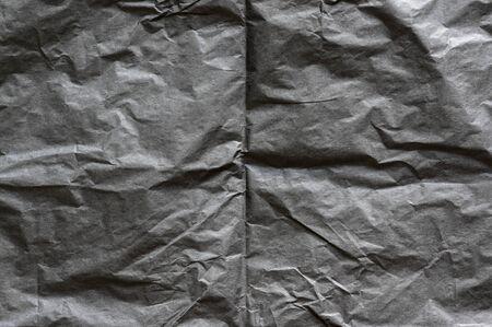 Black, creased, blank paper texture 版權商用圖片 - 150170591