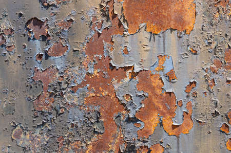Old, rusty, rough metal texture covered in patches of peeling off old paint 版權商用圖片