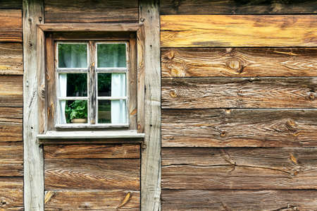 Close up on old cabin wall and window 版權商用圖片
