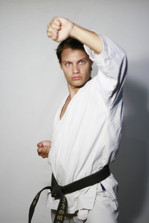 fearsome: Karate man with fearsome look does upper block