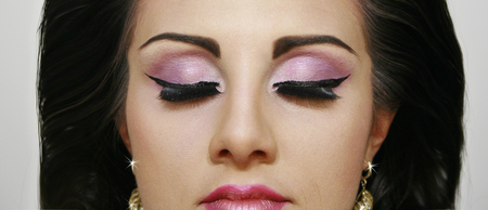 pinky: Beautiful fashion girl with closed eyes pinky eye shadows, face with red lips