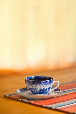 Vintage blue coffee cup on a wooden table Stock Photo - 15325285