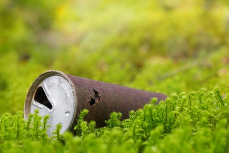 Old rusty beer can in nature, around 30 years old and starting to break down  Stock Photo - 15634643