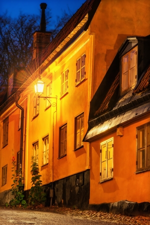 Dark alley with cobblestones in Stockholm lit by an old streetlight  Stock Photo - 16433952