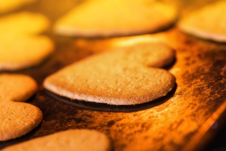 Christmas ginger cookies in the oven - warm light, warm atmosphere Stock Photo