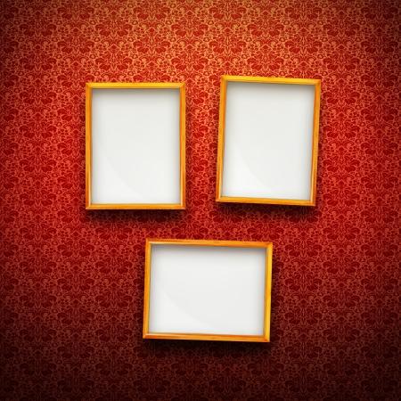 Three Picture frames in gold on red vintage background Standard-Bild