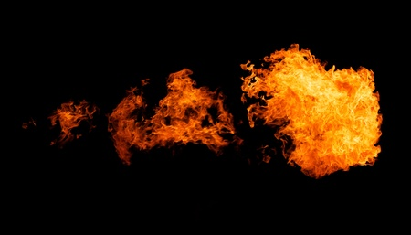 Fireflame bursting in one direction - isolated on black Stock Photo - 17597867