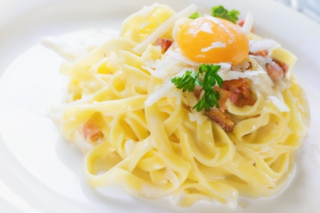 Pasta Carbonara - Tagliatelle with egg yolk, parsley and parmesan