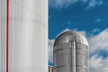 Heating Plant with red stripes and a aluminum silo in center Stock Photo