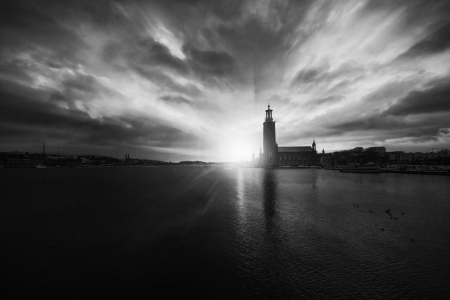 godlike: Black and white sunset view of the Stockholm City Hall, Sweden