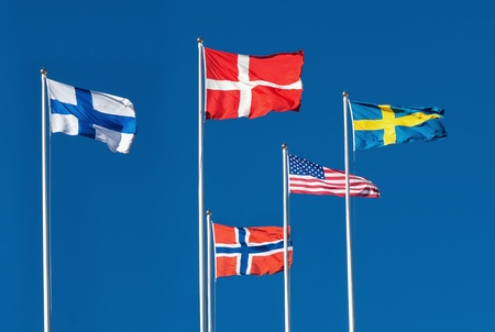 Scandinavian and The United States Flag on blue sky background photo