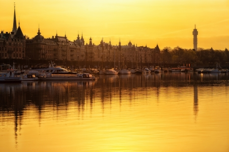 Sunrise over Strandvagen with boats on calm water, Stockholm, Sweden