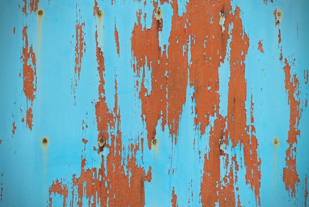 Turquoise background board with peeling paint  photo